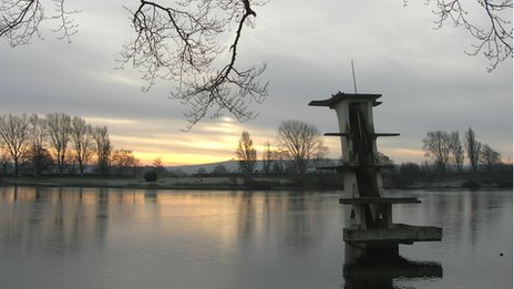 picture of concrete diving platform and lake