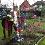 man and woman and tree decorated with pom poms
