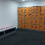 orange lockers and a bench