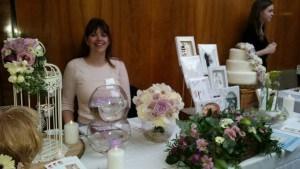 lady stood behind display table