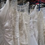 wedding dresses on a rail