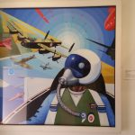 painting of a pilot with planes around him