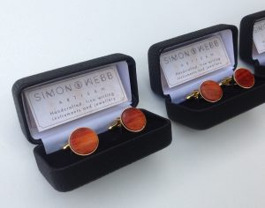 Round cufflinks in a box