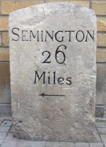 Swindons listed buildings -Canal marker stone on Canal Walk in Swindon
