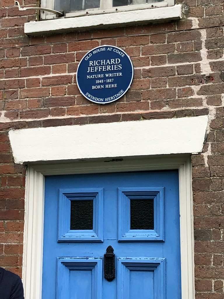 Blue plaque over the blue front door of the Richard Jefferies Museum.  Blue Plaque unveiled at  Richard Jefferies Museum.