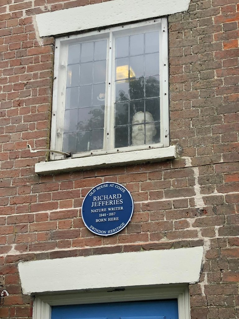 Bust of Richard Jefferies looking out of the window. Blue plaque over front door.