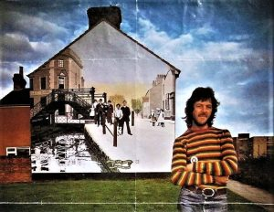 Ken White as a much younger man with the Golden Lion Bridge mural