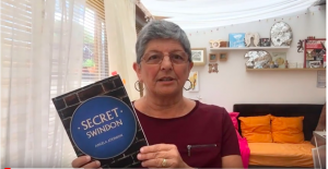 Angela Atkinson holding copy of Secret Swindon