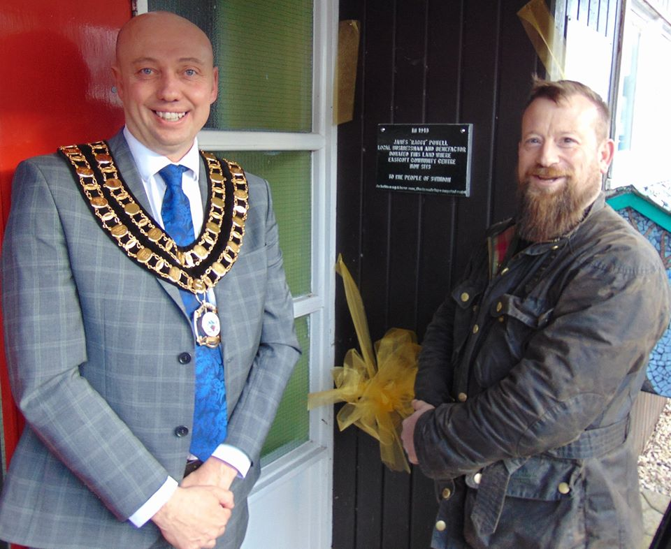 Toby Robson and the Mayor cut the plaque