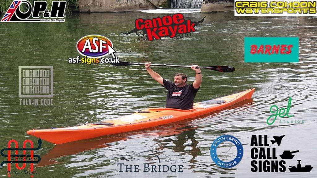 Graham Stobbs in Kayak with sponsorship badging