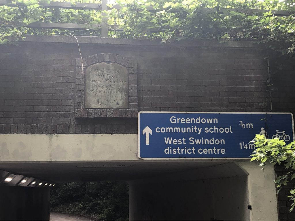 Old milestone set into an underpass
