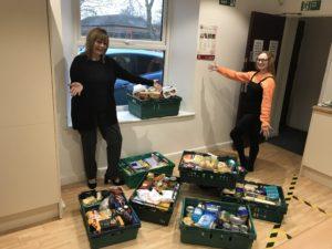 Optimum team boost charities' coffers - foodbank donations
