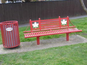Canadian Spitfire Pilot Memorial Swindon - red bench with Canadian maple leavs on it.