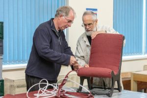 Shedders needed for Swindon Renew - two men working on a chair
