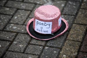 Poetry at the Oasis - pink sequinned bowler hat with label saying poetry in motion