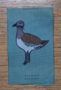 Girl guide badge showing the great bustard.