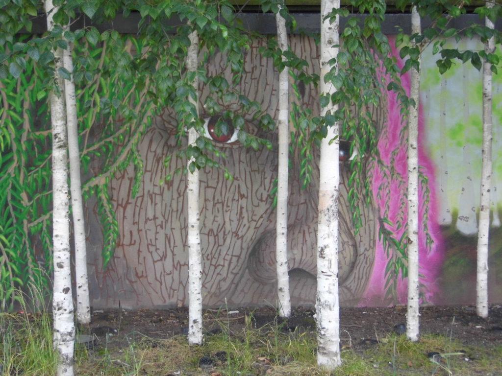 face on wharf green mural