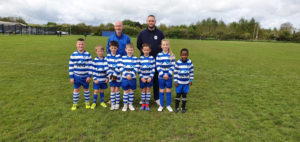 Ted Mortgages Gives Back to Football Club - Chris Blackwell with the football team