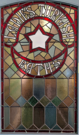 Stained glass saying Ladies Turkish Baths