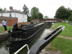 A Kennet and Avon Canal Journey - a canal boat navigating a lock